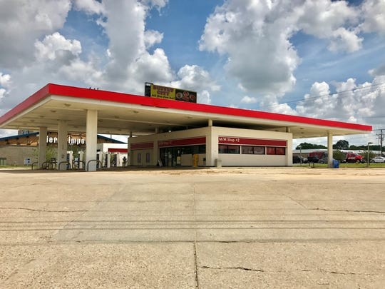 The former M&M Exxon at the corner of Johnston Street and Ambassador Caffery has closed and a new dental office is proposed to replace it on the property.