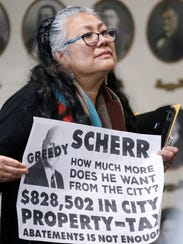 Selfa Chew holds up a sign as discussions focused once