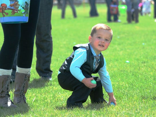 A boy searches for eeggs during the Yerington Rotary