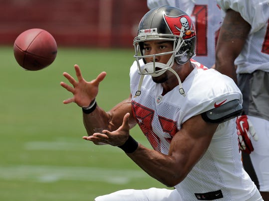 FILE - In this July 28, 2014 file photo, Tampa Bay Buccaneers wide receiver Vincent Jackson catches a pass during an NFL football training camp in Tampa, Fla. Jackson says he's about winning, and he believes the Bucs are ready to do more of that.  (AP Photo/Chris O'Meara, File)