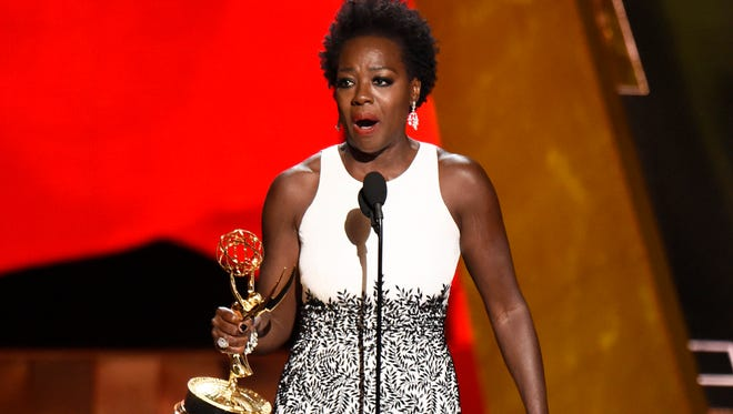 Viola Davis accepts the award for outstanding lead actress in a drama series for 'How to Get Away With Murder' at the 67th Primetime Emmy Awards on Sept. 20, 2015, at the Microsoft Theater in Los Angeles.