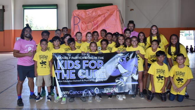 Guam Cancer Care held their Kids for the Cure program at Agana Heights Elementary School with over 200 student participants. Pictured is Ms. Yamashita and her 5th grade class who placed first, Principal Hannah Gutierrez, Kids for the Cure coaches and Guam Cancer Care staff.