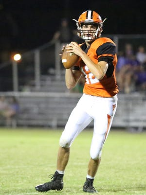 South Gibson quarterback Lou Rechis prepares to throw the ball last week against TCA.