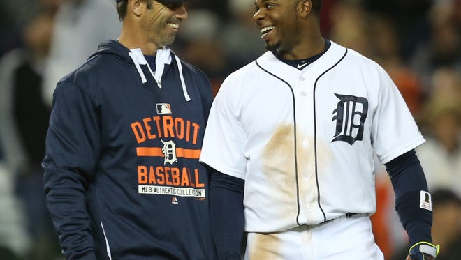 Tigers manager Brad Ausmus and designated hitter Rajai Davis talk after the Tigers' 6-2 win over the Astros Friday at Comerica Park.