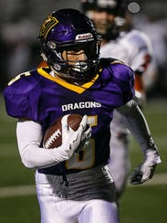 Johnston's Anthony Coleman runs during their game against