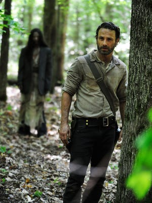 Andrew Lincoln, right, as Rick Grimes, in a scene from Episode 1 of 'The Walking Dead,' Season 4.