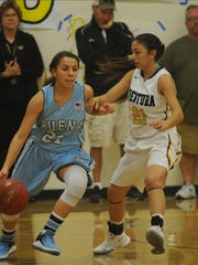 Buena's Jelly Orozco, left, tries to get past Ventura's Jazmin Carrasco during Thursday night's rivalry game.