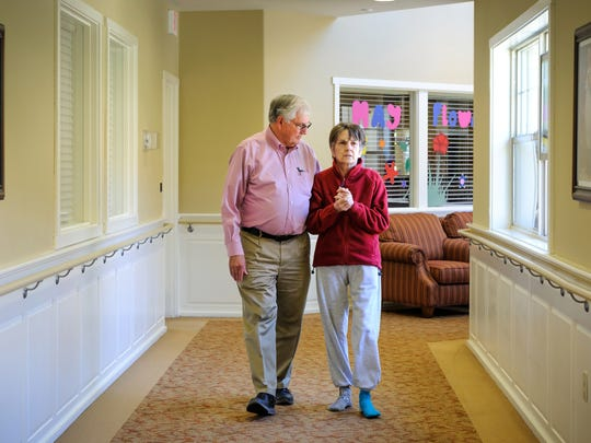 Bill Harris walks with his wife, Nora, at the Fern