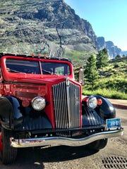 A Glacier red bus at Many Glacier.