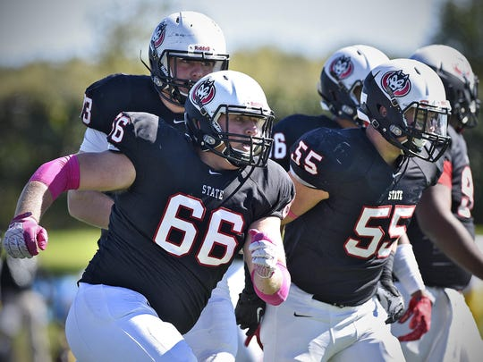 St. Cloud State's Jake Schley celebrates a big defensive play during Saturday's game between St. Cloud State and Minnesota-Crookston at Husky Stadium in St. Cloud.