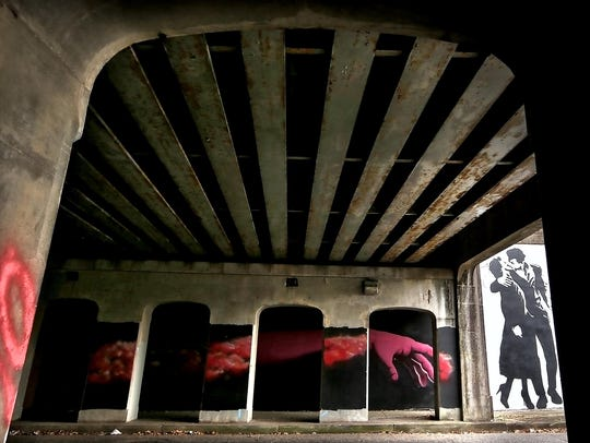Murals cover the walls of the railroad underpass near