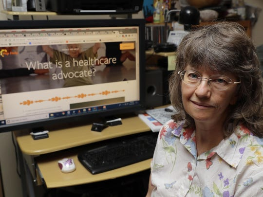 In this Aug. 22, 2018 photo, April Box poses for a photo at her home in Spokane, Wash. Box is a healthcare advocate and runs the website www.hip-help.com to help guide people through major surgeries and other aspects of the healthcare system. Millions of people covered under the Affordable Care Act will see only modest premium increases next year, and some will get a price cut. That's the conclusion from an exclusive analysis of the besieged but resilient program that still divides voters heading into this year's midterm elections. (AP Photo/Ted S. Warren)