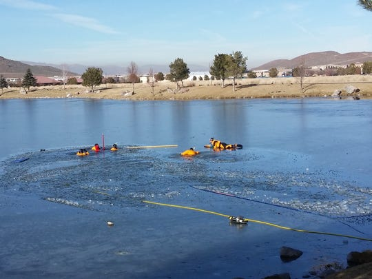 Firefighters looking for a child who fell through ice in a pond in South Reno.