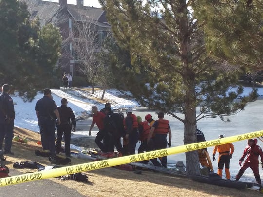 Rescue crews pull a teen from a frozen pond near the Vintage apartments in South Reno.