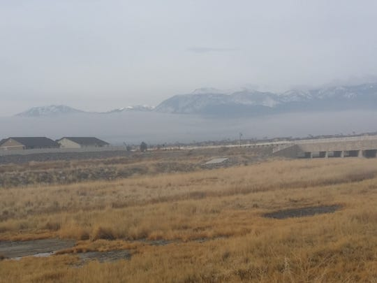 Fog is seen in the distance in south Reno on Tuesday morning.