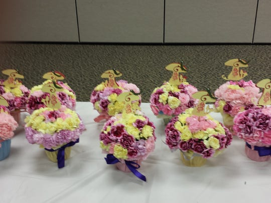 "Youth Group ""Cupcakes"" decorated with flowers."