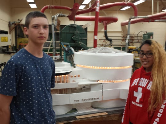 "MCVTS students Dylan Stratton of East Brunswick and Ashly Rahman of New Brunswick show off ""The Doggenheim,"" a doghouse modeled after the Guggenheim Museum in New York City."