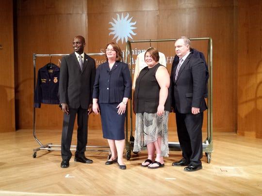 Karlene Krueger, of Campbellsport, second from right,