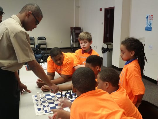 Johnny Means teaching chess at Southbridge Community