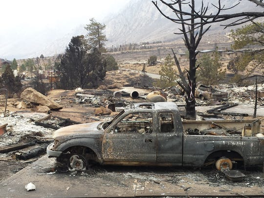 Vehicles are burned and homes are reduced to rubble