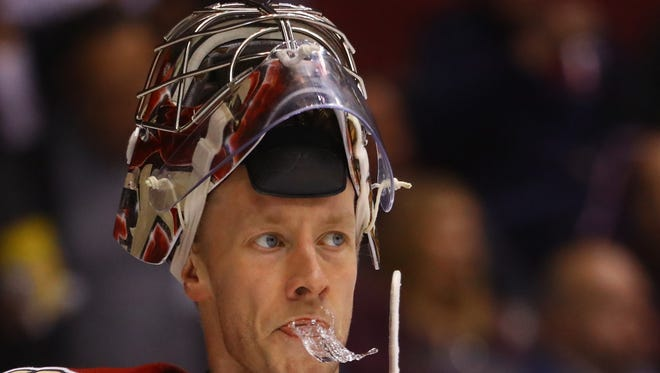 Jan 25, 2018; Glendale, AZ, USA; Arizona Coyotes goalie Antti Raanta spits water out of his mouth in the second period against the Columbus Blue Jackets at Gila River Arena. Mandatory Credit: Mark J. Rebilas-USA TODAY Sports