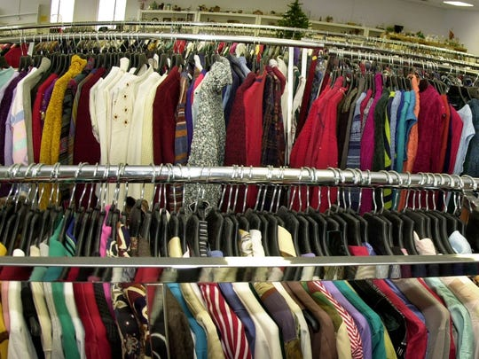 In this file photo, clothes hang on the racks at a Volunteers of America store in Brockport.