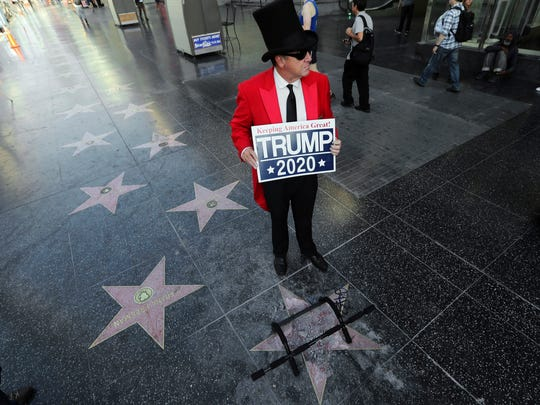 Gregg Donovan stands near the vandalized star of Donald