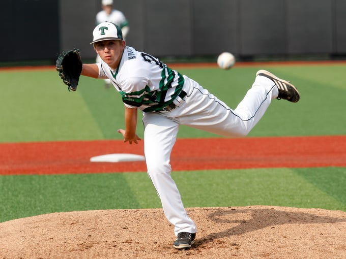 Trinity's Paxton Rousseau, #28, delivers a pitch against Male during the Seventh Region semifinal at Jim Patterson Stadium.   May 27, 2014