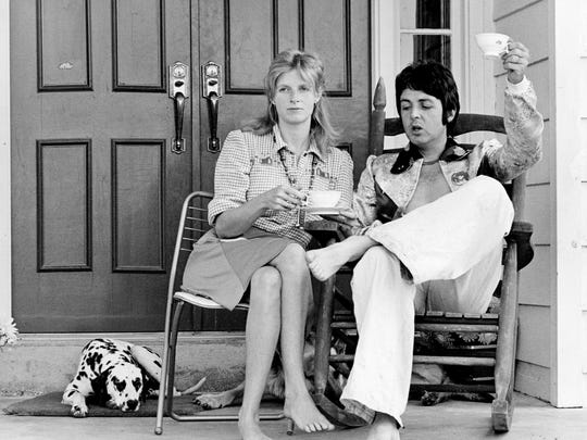 """Paul McCartney, right, and wife, Linda, who've been living the life of country gentlefolks on the Putman farm for the past five weeks, offer a toast to other """"down home folks."""" They held a highly informal press conference on the porch with a host of newsmen July 17, 1974."""