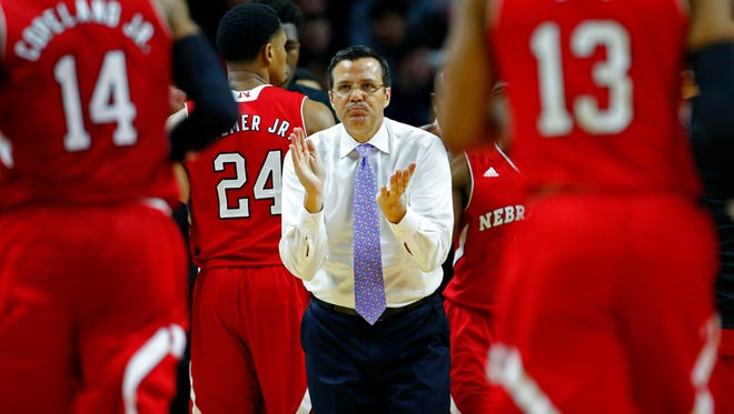 Nebraska Cornhuskers head coach Tim Miles applauds his team during a time out against Rutgers Scarlet Knights at Louis Brown Athletic Center.