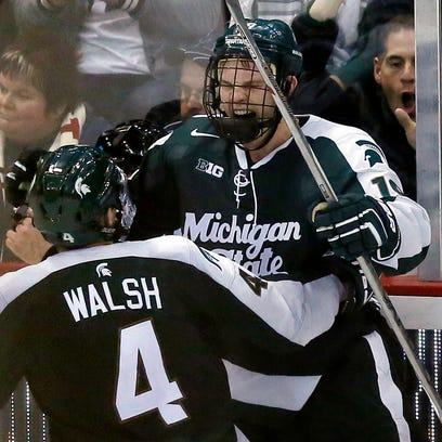 Michigan State's Matt DeBlouw, right, celebrates with