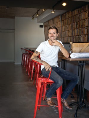 In characteristic pared-down attire, Chris Pardo takes a break at Ernest Coffee in Palm Springs.
