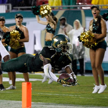 Bulls wide receiver Rodney Adams  scores a touchdown during the first half against the Connecticut Huskies at Raymond James Stadium.