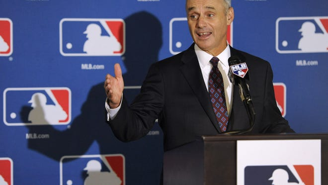 Major League Baseball Chief Operating Officer Rob Manfred speaks to reporters Thursday after team owners elected him as the next commissioner.