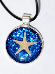 A tiny starfish is suspended in resin for a keepsake