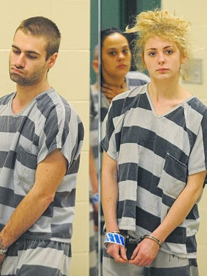 Torey Wohl (left) and Ashley Haman are escorted into Minnehaha County Court Friday, Jan. 29, 2016, in Sioux Falls.