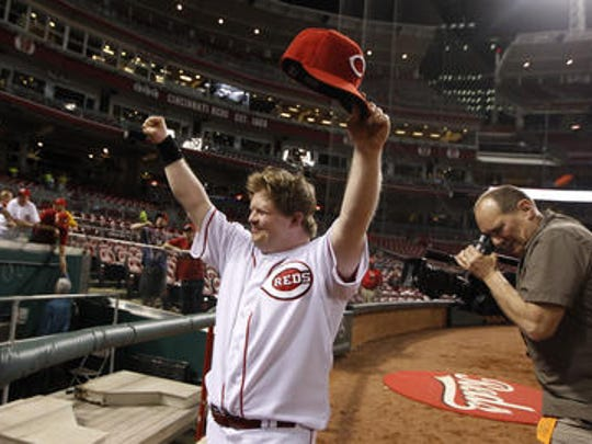 Cincinnati Reds guest bat boy Teddy Kremer acknowledges