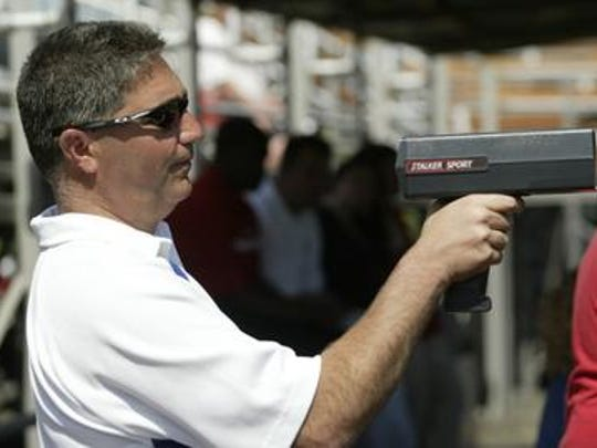 Mike Garlatti of Edison is a scout for the Colorado Rockies. He is using a radar gun while watching the pitchers as he scouts a Rutgers-Delaware game in 2007 in Piscataway.