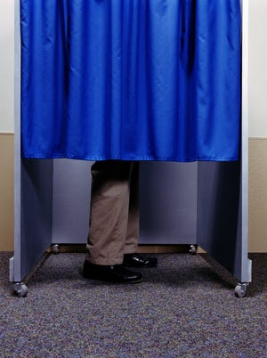Wisconsin election officials were scrambling Monday to deal with a federal appeals court's ruling reinstating the requirement that voters show photo identification when casting ballots.
