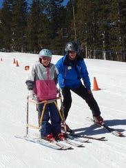 SAAS instructor Dave Ingels skiing with NMSBVI student