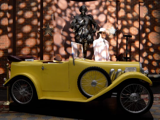 """A convertible car and costume from ASF's 2014 production of the Great Gatsby, created one of the many vignettes showcased for the celebration of 30 years since the theatre was moved to Montgomery through the generosity of Carolyn and """"Red"""" Blount."""