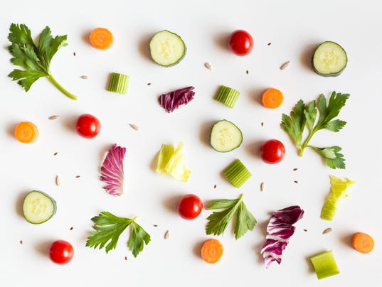 Eating food pattern with raw ingredients of salad on white background