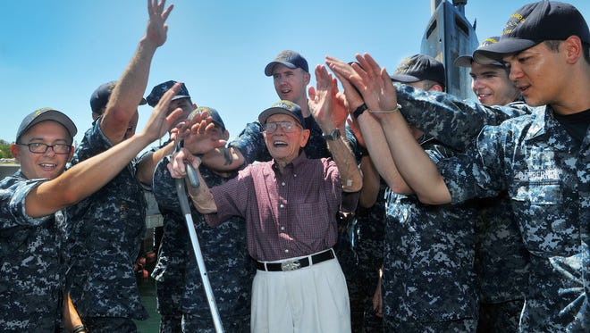 Dale Christian, a 93-year-old  World War II veteran and former submariner, spends time with the crew of the USS Minnesota at Port Canaveral.