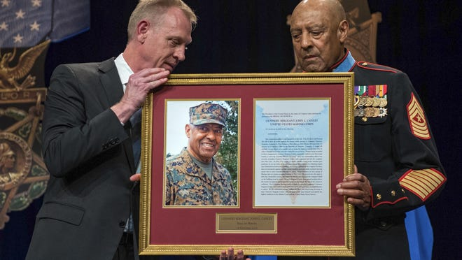 U.S. Deputy Secretary of Defense inducts U.S. Marine Corps Sgt. Maj. (Ret.) John L. Canley into the Hall of Heroes during a ceremony at the Pentagon in Washington, D.C., on Oct. 18, 2018, after being awarded the Medal of Honor by President Donald Trump. Canley is the 300th Marine Medal of Honor recipient. Canley was born in Caledonia , Arkansas, and enlisted in the United States Marine Corps in Little Rock.