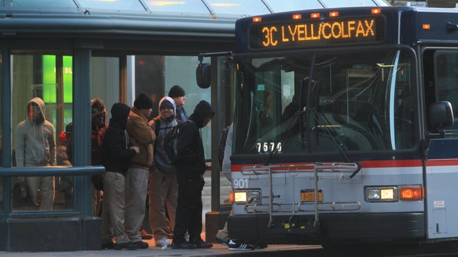 Commuters get on an RTS bus on Main Street downtown.
