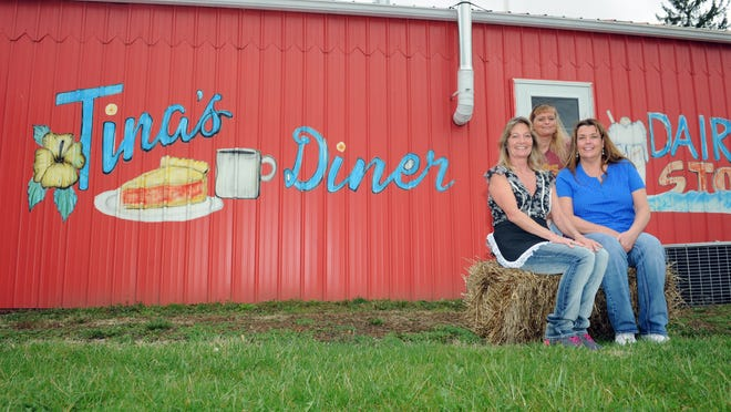 Tina Burkett, owner, Tina Humphrey, employee, and Annette Taylor, employee, from right sit outside Burkett's restaurant, Tina's Diner, in Roseville. Burkett has owned the restaurant for nearly eight years and uses mostly locally bought products for her business.
