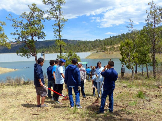 Students gather for more assignments at the lake.