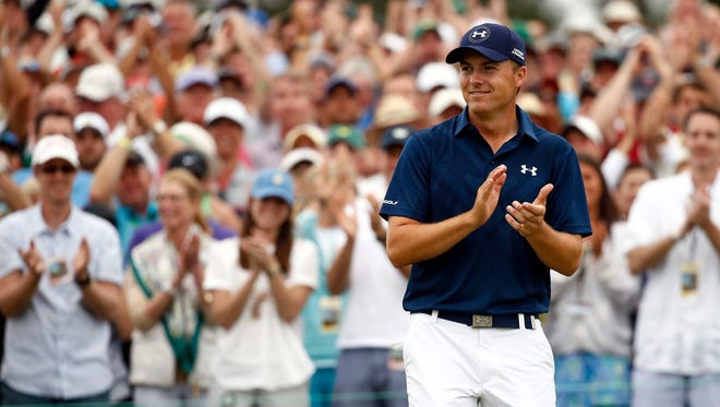 Jordan Spieth celebrates on the 18th green after winning The Masters at Augusta National Golf Club.