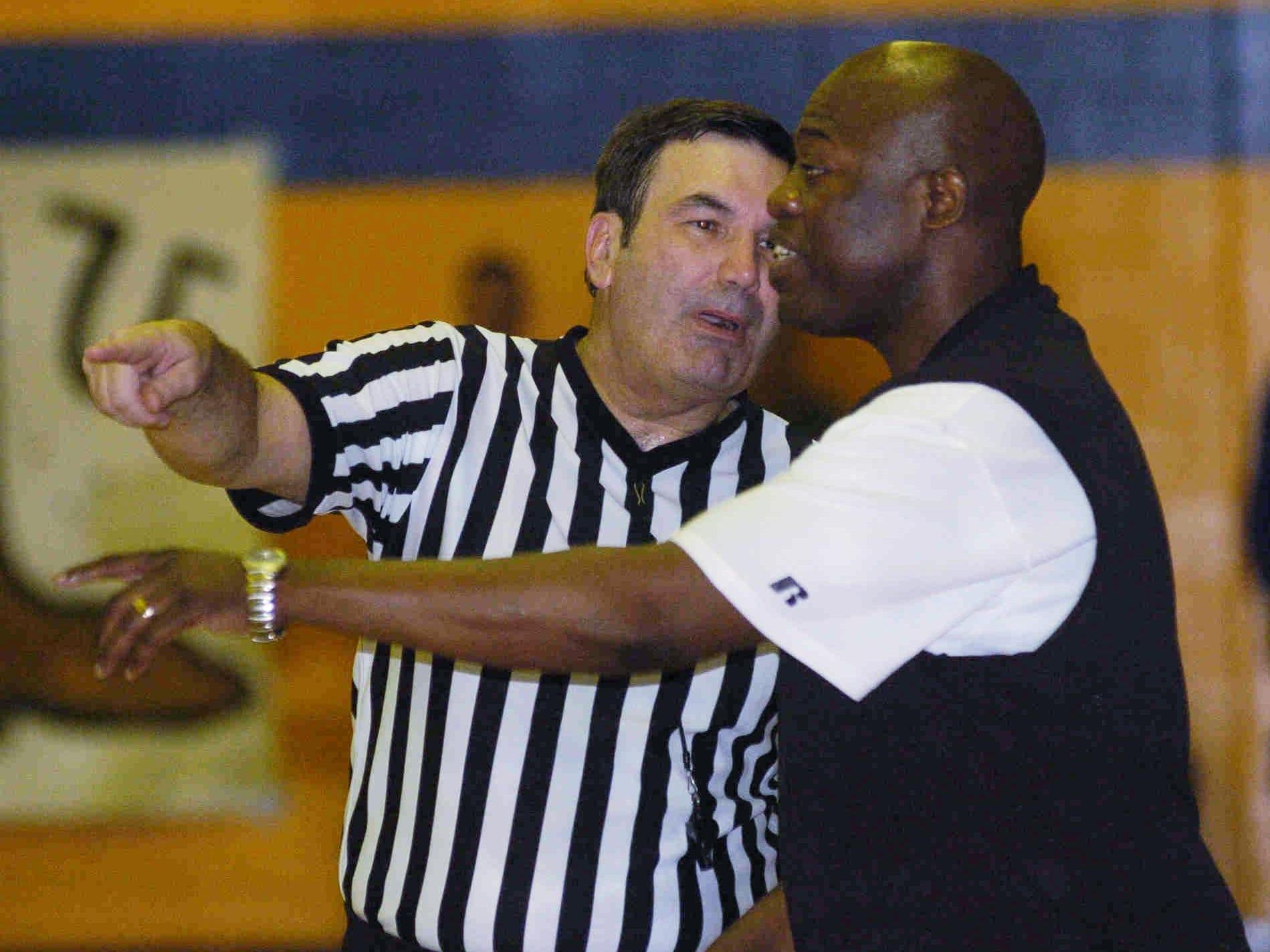 Huntington head coach Mack Jones talks with a referee.