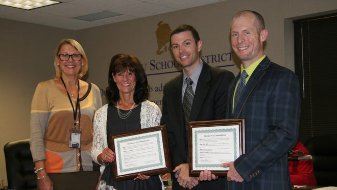 Superintendent Kathleen Williams, from left, fourth-grade teacher Jena Lawson, School Board President Lance Trollop, and social studies teacher Paul Clark celebrate Kohl fellowships awarded to Lawson and Clark.